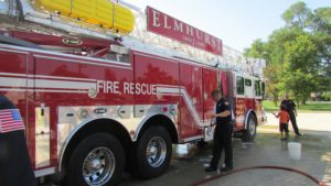 City of Elmhurst unveils new fire truck  Ladder vehicle for first-responders blessed by Father Andrew
