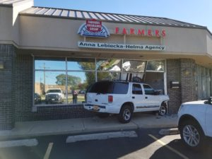 Driver charged with DUI after crashing into business