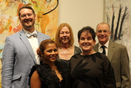 """Pictured above are members of the coordinating committee for the Elmhurst Yorkfield Food Pantry's """"Art Beats"""" gala held Wednesday, Nov. 6. They are (from left): Kevin Kost, Kai Sison MacNicol, Nancy Peterson, Maureen Barry and Brian Bergheger.  Pictured at right enjoying the evening at the Elmhurst Art Museum are (from left): Lianne Sundberg, artist Tom Wolfe, Kurt Sundburg and Angie Udelhofen. Wolfe had created one of the art pieces available for the silent auc-tion."""